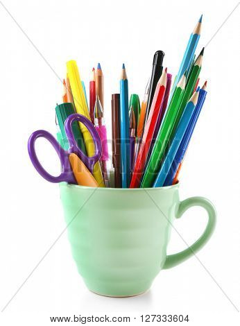 Colorful stationery in green cup, isolated on white