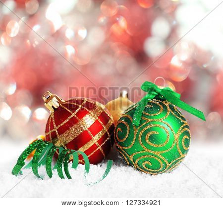 Christmas balls on shiny red background