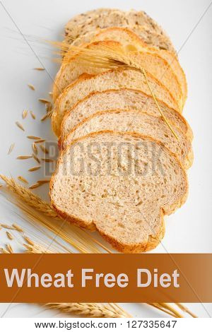 Slices of bread and ears isolated on white. Health and diet concept
