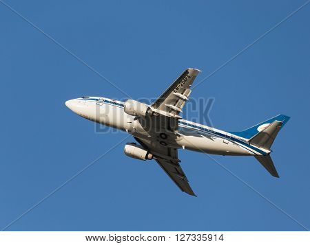 Moscow - August 20 2015: Large passenger plane Boeing 737-505 Belavia Belarusian Airlines International Airlines flies to Domodedovo airport and the blue sky August 20 2015 Moscow Russia