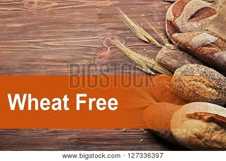 Fresh baked bread on the wooden background. Health and diet concept