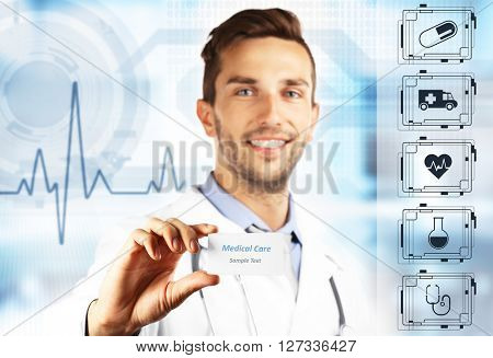Doctor with business card on virtual screen. Medical technology concept