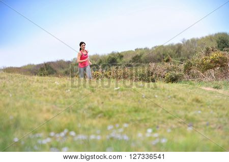 Woman running in the countryside