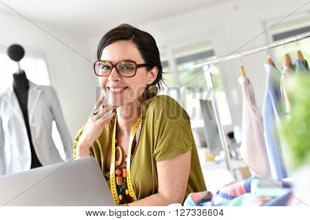 Successful woman designer working on project