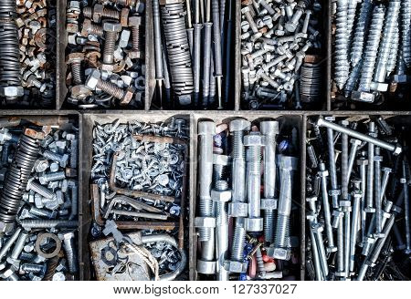 Piles of nuts bolts and washers for sale at a local market in Russia.