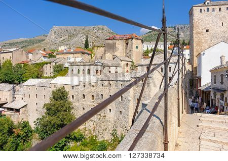 MOSTAR BOSNIA AND HERZEGOVINA - SEPTEMBER 1 2009: View of the old town east side through the railings of the Old Bridge