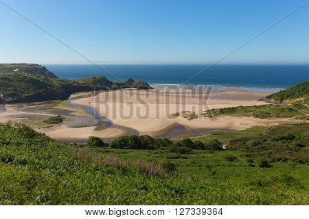 The Gower coast Three Cliffs Bay Wales uk in summer sunshine beautiful part of the peninsula