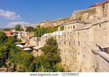 MOSTAR BOSNIA AND HERZEGOVINA - SEPTEMBER 1 2009: View of the old town east side from the Old Bridge