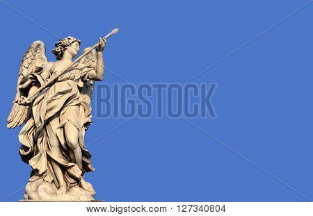Marble statue of angel holding the Holy Lance of Longinus from Sant'Angelo bridge monumental balustrade in the center of Rome (17th century)