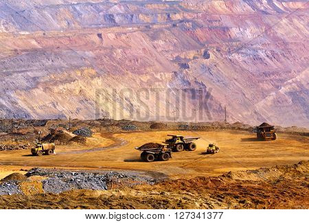 Big dump-body track bring the depleted iron ore to the dumps