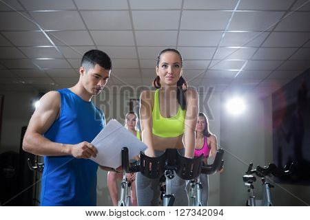 Sport coach and girl indoors