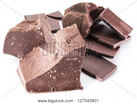 Chocolate blocks and pieces of chocolate bar isolated on a white background.