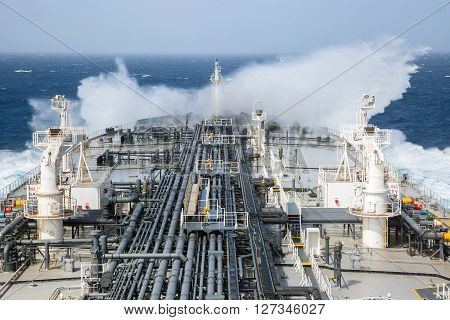 Wave breaking against the oil tanker bow