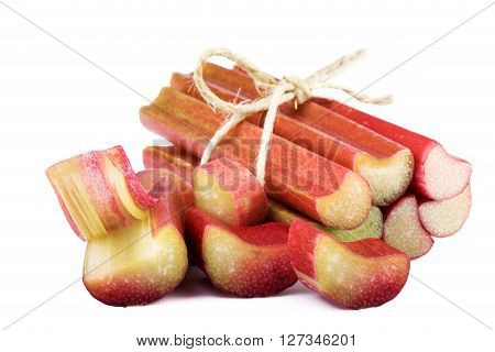 Bundle of rhubarb stalks on white background