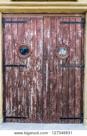 Old wooden door with big spy hole.