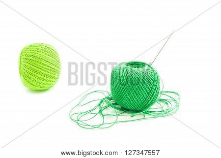 Spools Of Green Thread And Needle