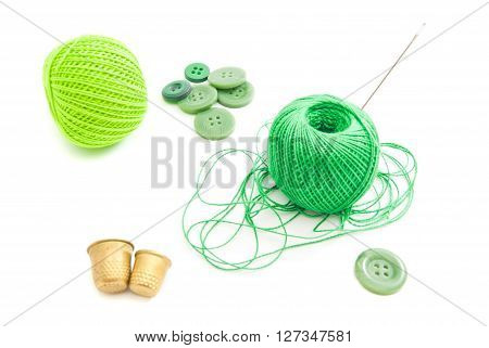 Spools Of Thread, Thimbles And Green Buttons