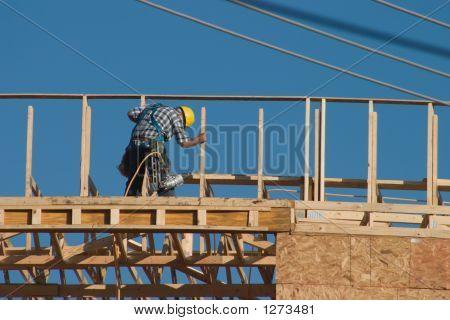 Construction Worker And Nail Gun
