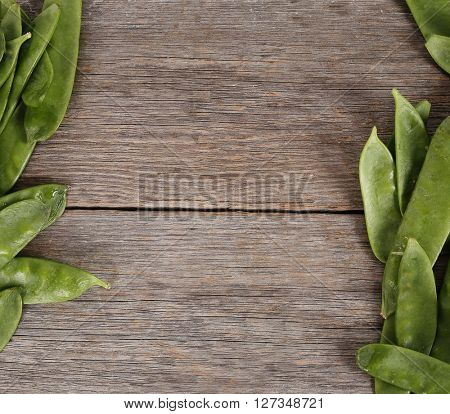 Vegetable. Green peas on the wooden table