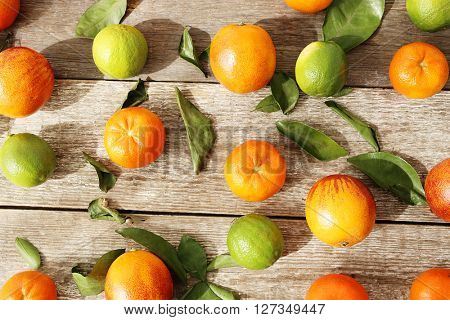 Tangerine and lime on the table