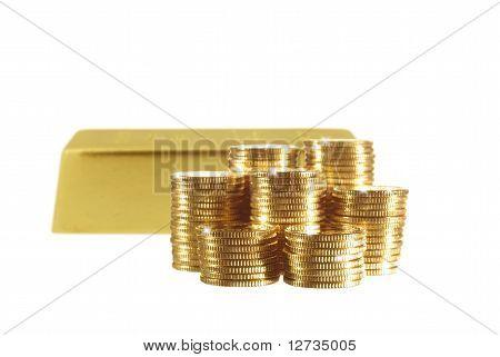 Moeda e barra de ouro