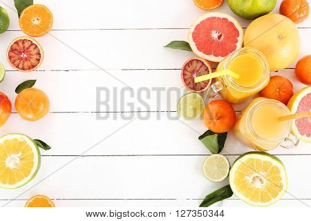 Various citrus fruits with a drink on the table