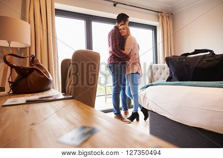 Romantic Couple With Hotel Room Key In Foreground