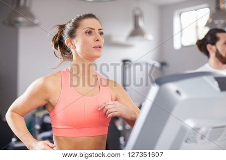 Mature Woman Running On Treadmill In Gym