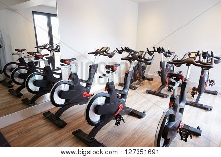 Row Of Spinning Bikes In Gym