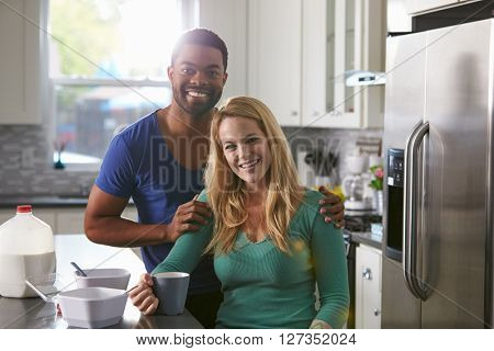 Portrait of mixed race couple in their kitchen