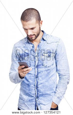 Smart man reading a message on his smartphone, isolated on white background