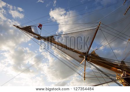 forward mast of the sailing ship against the sky