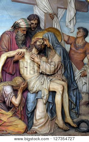 ZAGREB, CROATIA - SEPTEMBER 14: 13th Stations of the Cross,Jesus' body is removed from the cross, Basilica of the Sacred Heart of Jesus in Zagreb, Croatia on September 14, 2015