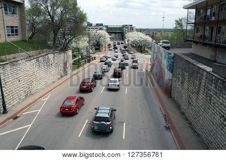 JOLIET, ILLINOIS / UNITED STATES - APRIL 19, 2015: Traffic moves along Jefferson Street towards the Jefferson Street Bridge downtown Joliet.