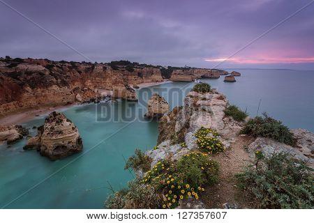 Mythic sunrise on the beach Marinha. Portugal.