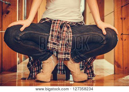 Closeup Woman Legs In Denim Jeans And High Heels