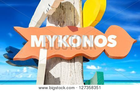 Mykonos signpost with beach background