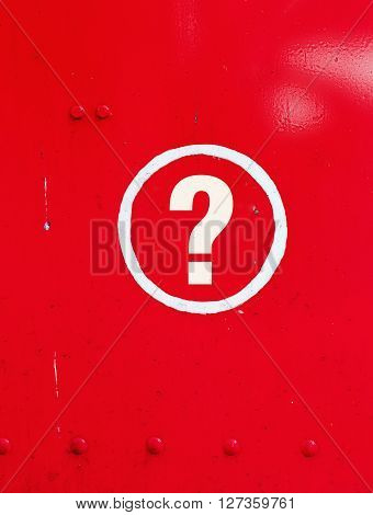 Question sign in red metal with circle
