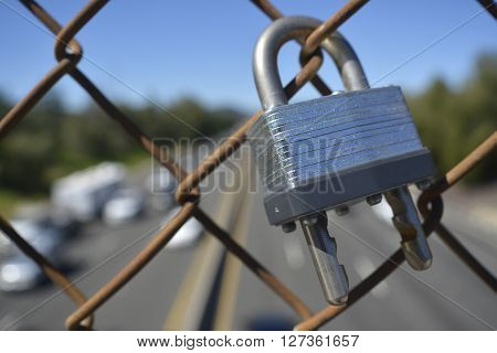 Lock attached to fence over a freeway overpass