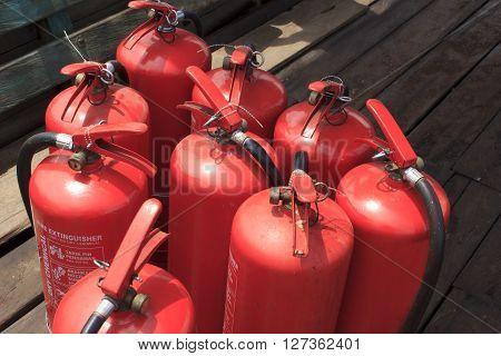 Nine fire extinguishers on the wood floor
