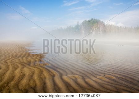 Spring landscape with fog on the river. Russia Siberia Novosibirsk region Ob river