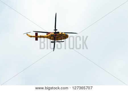 TORONTO CANADA - AUGUST 31 2014: A Canadian Armed Forces Search and Rescue CH-146 Griffon helicopter passes overhead under overcast skies.