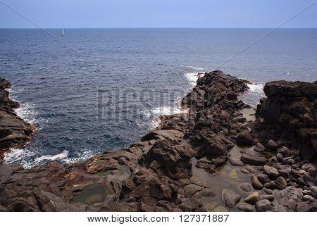 The coast of lava stone in Catania