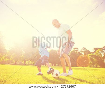 Family Father Son Leisure Football Playing Concept