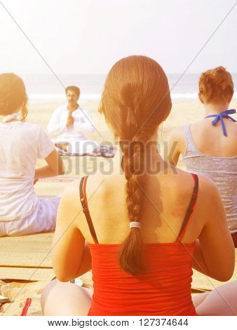 Class of Yoga by the Beach Concept