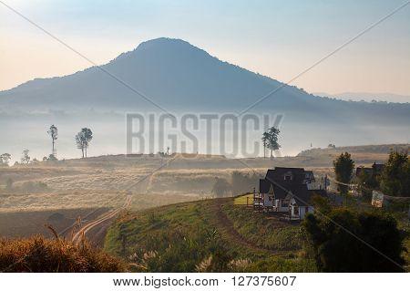 Misty Morning Sunrise And House In Khao Takhian Ngo View Point At Khao-kho Phetchabun,thailand