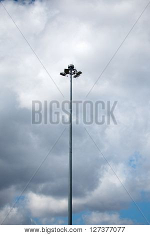 tall lamppost on a background cloudy sky