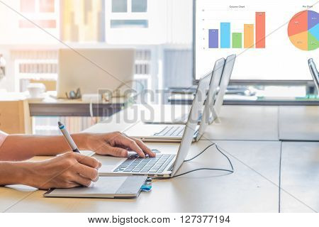 Businessman making presentation on LED display in office