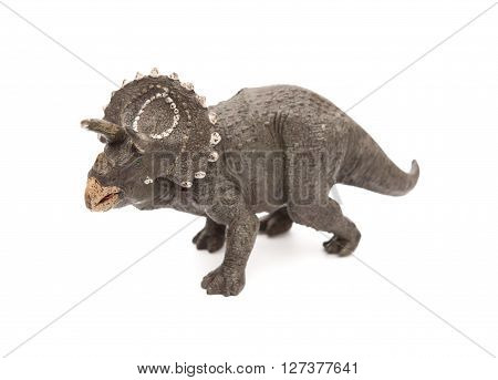 grey triceratops toy on a white background