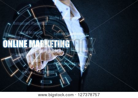 The businessman pointing the blue and orange circle of light by focusing on strategy of online marketing. This picture suitable for business and technology use.